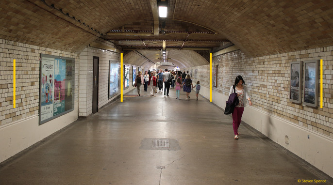 Sunsets: South Kensington London, UK tube station path to the museums. Most people perceive the yellow bars on the outside edges as smaller than the bars in the middle section. All bars are the same size.