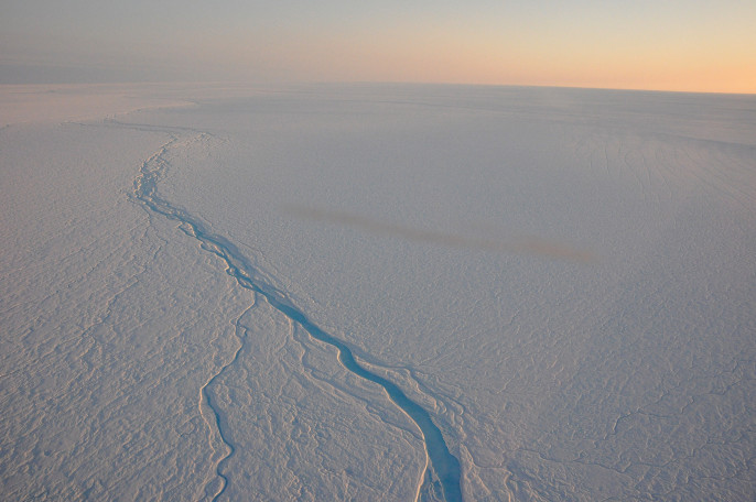 Meltwater rivers gushing on top of the ice layers in Greenland